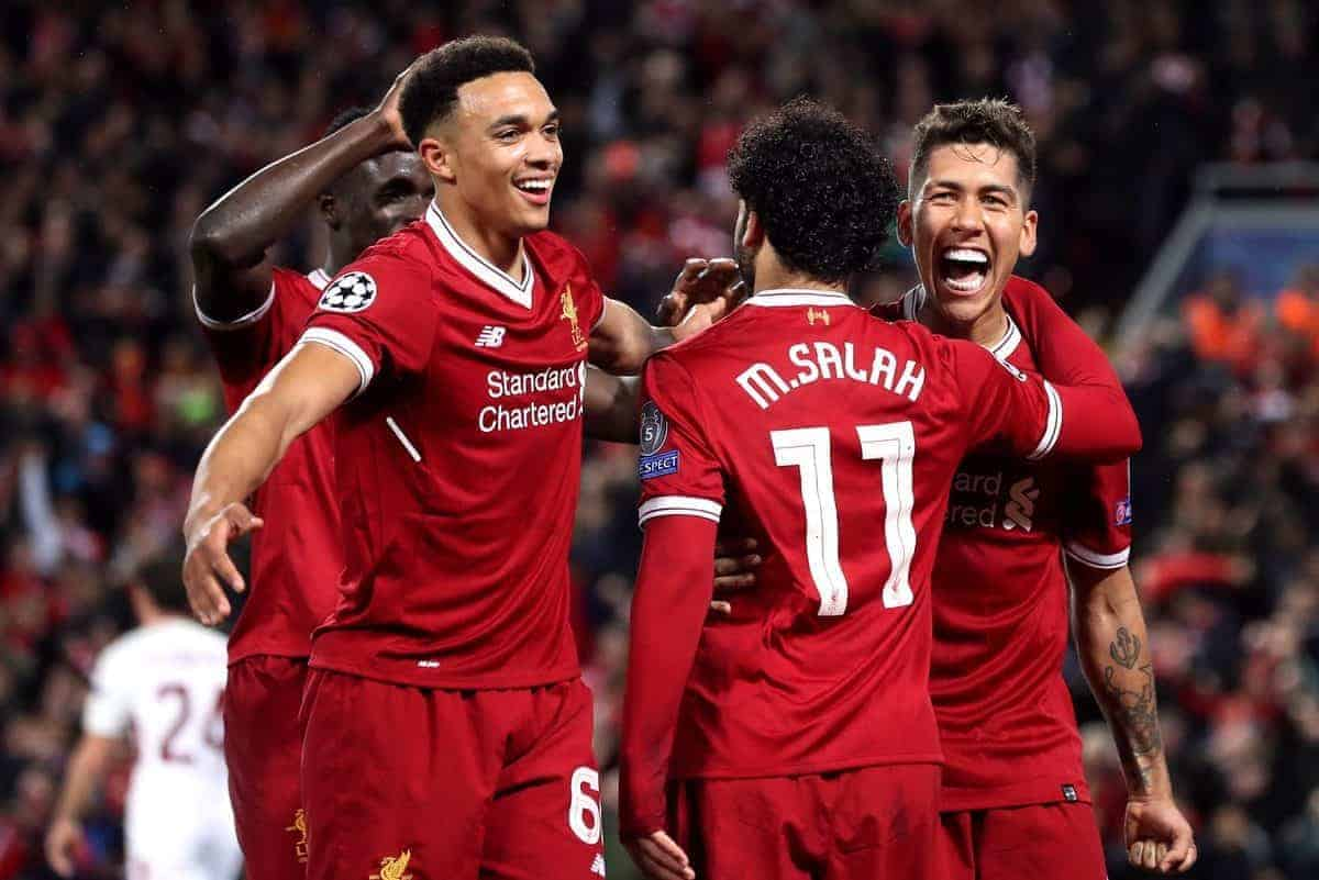 Liverpool's Roberto Firmino (right) celebrates scoring his side's fourth goal of the game with Mohamed Salah and Trent Alexander-Arnold (left) (Martin Rickett/EMPICS Sport)