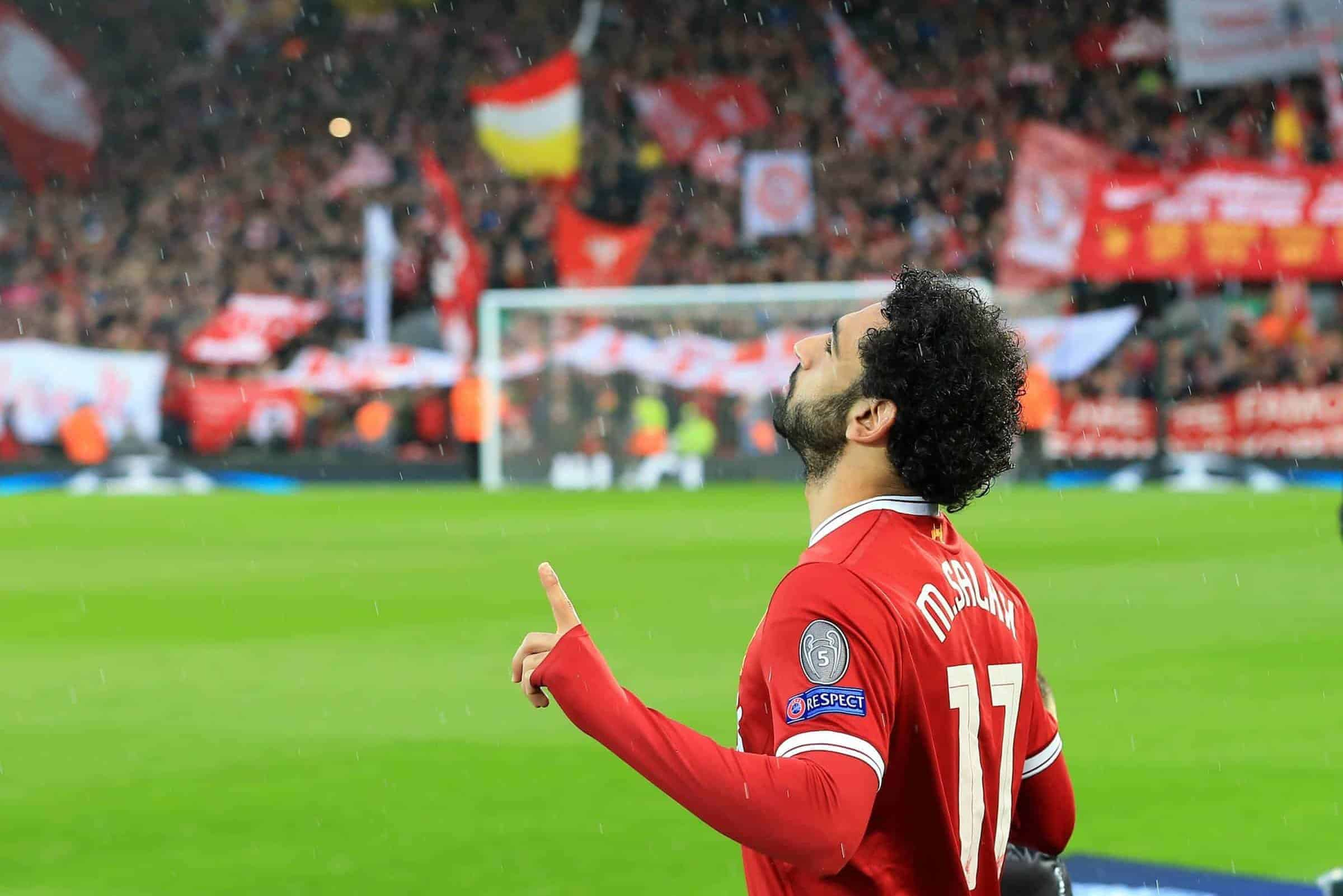24th April 2018, Anfield, Liverpool, England; UEFA Champions League football, semi final, 1st leg, Liverpool versus AS Roma; Mohamed Salah of Liverpool says a prayer as he takes to the field in front of the Kop
