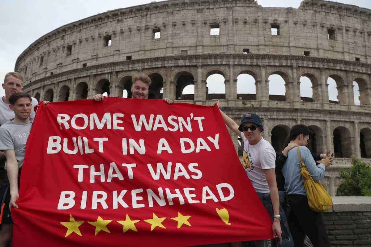 Liverpool FC fans (left to right) Josh Mitchell, James Beattie and Adam Beattie, hold up a banner in front of the Colosseum in Rome ahead of the UEFA Champions League, Semi Final Second Leg match at the Stadio Olimpico against AS Roma on Wednesday.
