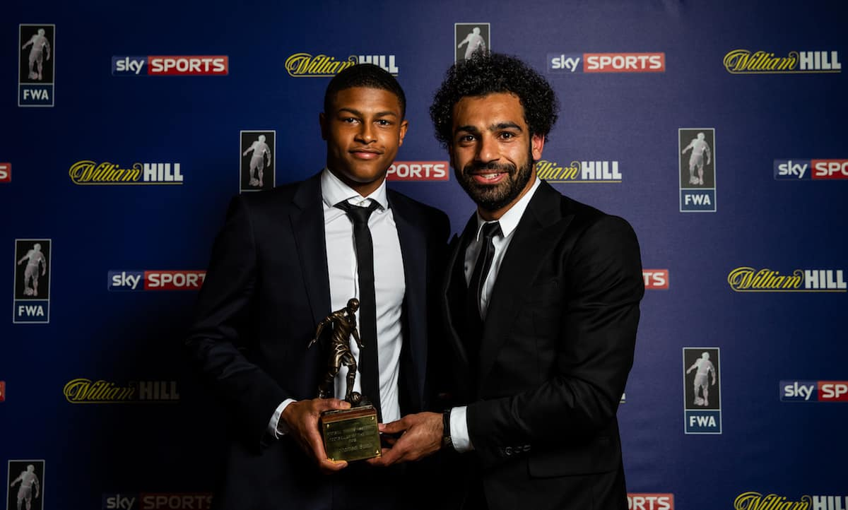 Liverpool's Mohamed Salah poses with his FWA Footballer of the Year 2018 award alongside team-mate Rhian Brewster during the FWA Footballer of the Year Dinner at The Landmark Hotel, London.
