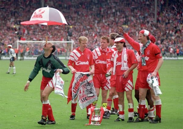 Bruce Grobbelaar clowns around as the Liverpool team celebrate their FA Cup win in 1992 (Picture by: Ross Kinnaird / EMPICS Sport)
