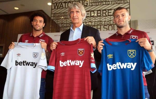West Ham manager Manuel Pellegrini (centre) with Felipe Anderson (left) and Jack Wilshere Adam Davy/PA Wire/PA Images)