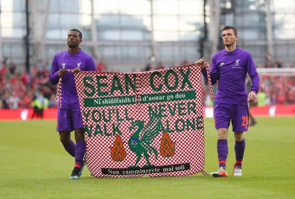 Liverpool's Georginio Wijnaldum (left) and Andy Robertson hold a banner for Liverpool fan Sean Cox after the pre-season friendly match at the Aviva Stadium (Niall Carson/PA Wire)