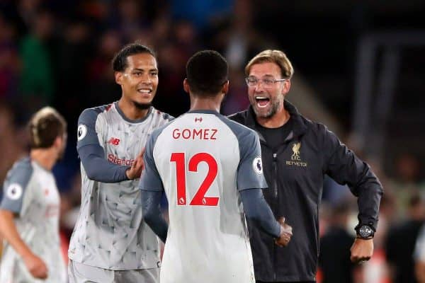 Liverpool manager Jurgen Klopp celebrates with Joe Gomez and Virgil van Dijk after the Premier League match at Selhurst Park, London. Nick Potts/PA Wire.