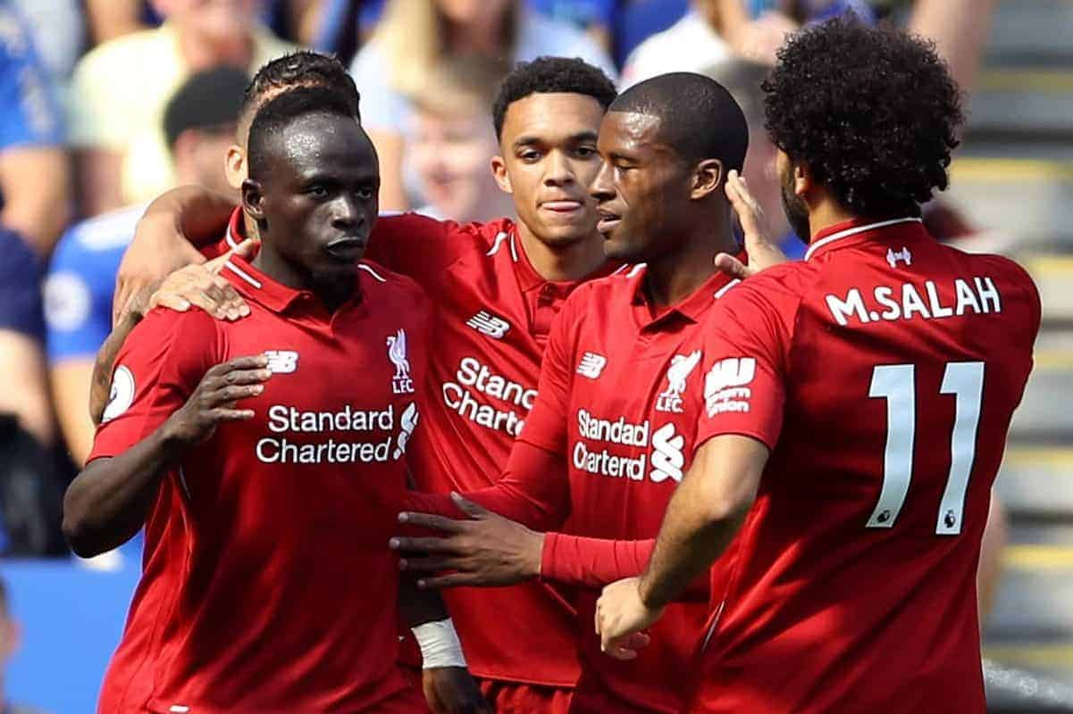Liverpool's Sadio Mane (left) celebrates scoring his side's first goal of the game with his team-mates
