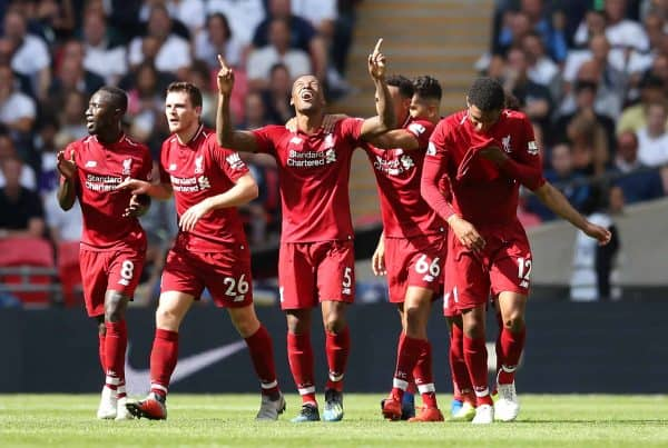 Liverpool's Georginio Wijnaldum (centre) celebrates scoring his side's first goal of the game with team gates during the Premier League match at Wembley Stadium, London. ( Adam Davy/PA Wire/PA Images)