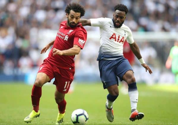 Liverpool's Mohamed Salah (left) and Tottenham Hotspur's Danny Rose battle for the ball during the Premier League match at Wembley Stadium, London.