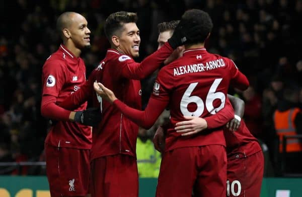 Liverpool's Roberto Firmino (second left) celebrates scoring his side's third goal of the game with team mates during the Premier League match at Vicarage Road, Watford.