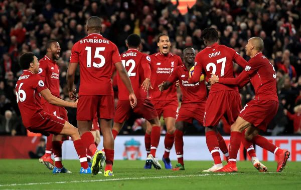 Liverpool's Divock Origi (second right) celebrates scoring his side's first goal of the game with team mates during the Premier League match at Anfield, Liverpool. (Peter Byrne/PA Wire/PA Images)