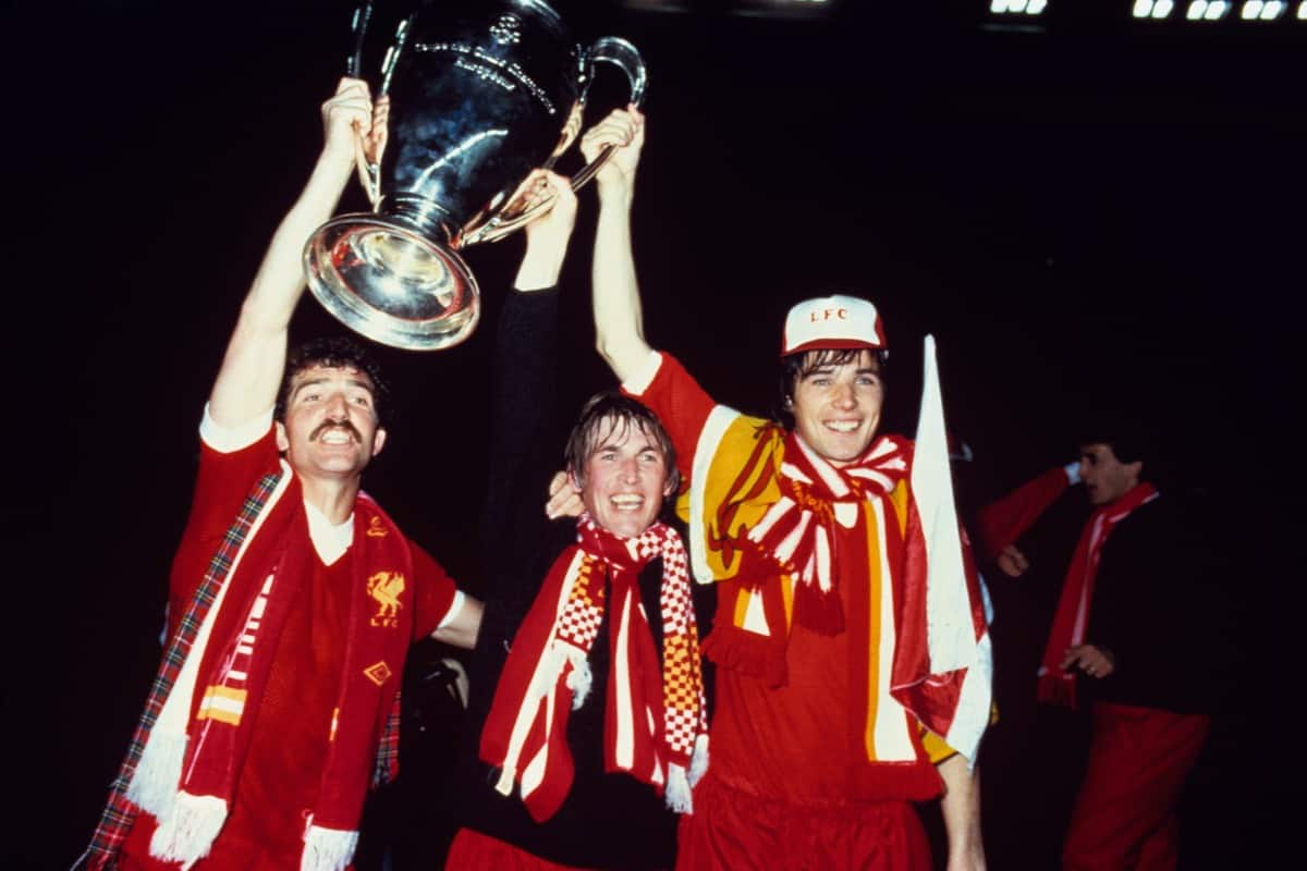 (L-R) Liverpool's Graeme Souness, Kenny Dalglish and Alan Hansen celebrate with the European Cup, 1981 (Peter Robinson/EMPICS Sport)
