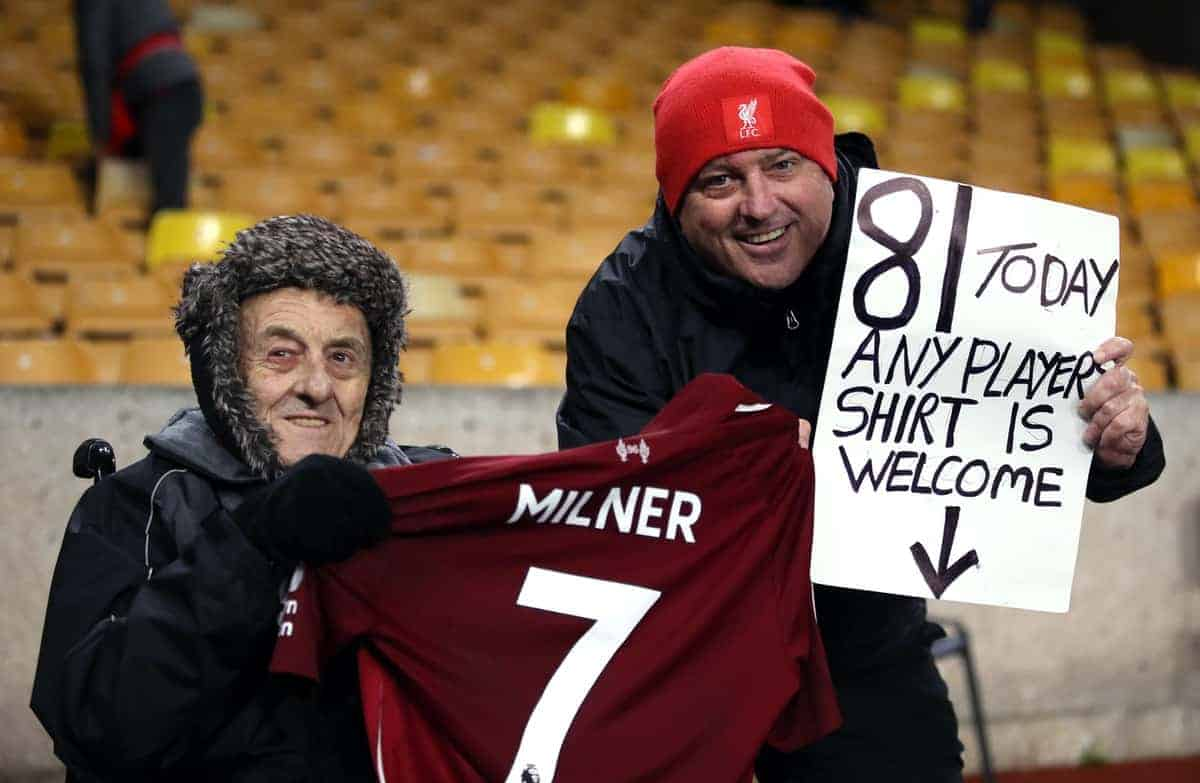 Liverpool fans pose with a shirt from James Milner after the Premier League match at Molineux, Wolverhampton (Nick Potts/PA Wire/PA Images)