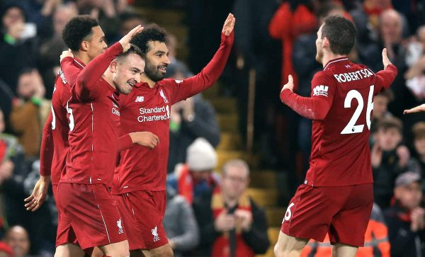 Liverpool's Xherdan Shaqiri (second left) celebrates scoring his side's third goal of the game with team-mates during the Premier League match at Anfield, Liverpool. (Peter Byrne/PA Wire/PA Images)