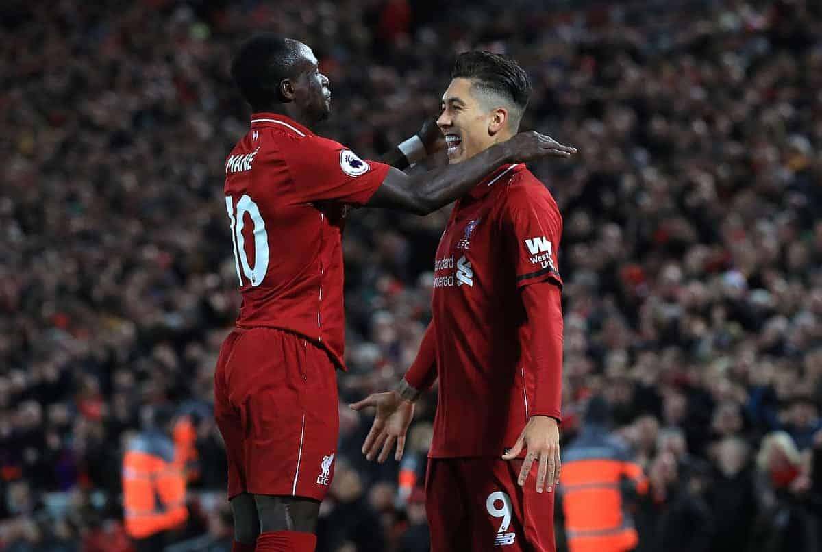 Liverpool's Roberto Firmino (right) celebrates scoring his side's first goal of the game with team-mate Sadio Mane during the Premier League match at Anfield, Liverpool (Peter Byrne/PA Wire/PA Images)