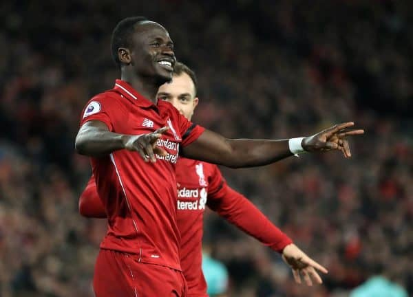 Liverpool's Sadio Mane (left) celebrates scoring his side's third goal of the game during the Premier League match at Anfield, Liverpool (Peter Byrne/PA Wire/PA Images)