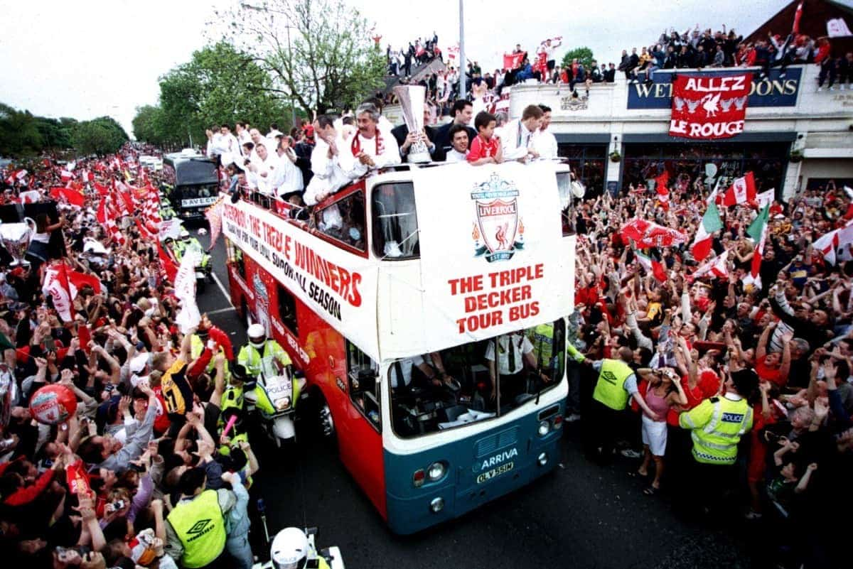 Liverpool fans line the streets as the team parade the three trophies won during season 2000-2001 season ( Matthew Ashton/EMPICS Sport)