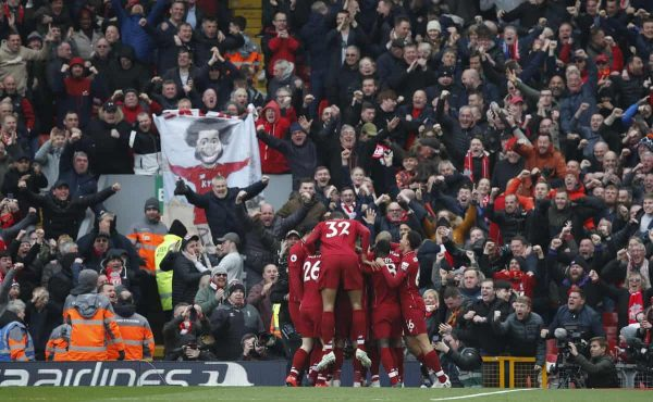 Mohamed Salah of Liverpool is mobbed as he celebrates scoring the second goal during the Premier League match at Anfield, Liverpool. Picture date: 14th April 2019. Picture credit should read: Andrew Yates/Sportimage via PA Images