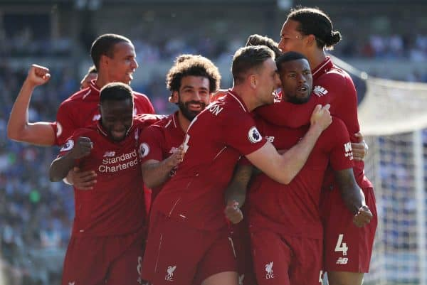 Liverpool's Georginio Wijnaldum (second right) celebrates scoring their first goal during the Premier League match at The Cardiff City Stadium, Cardiff. (David Davies/PA Wire/PA Images)