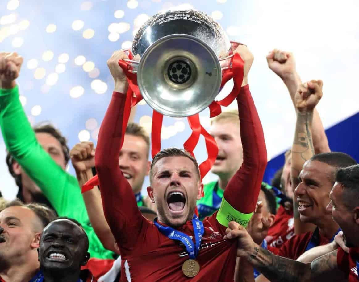 Liverpool's Jordan Henderson lifts the trophy after the final whistle during the UEFA Champions League Final at the Wanda Metropolitano, Madrid. PRESS ASSOCIATION Photo. Picture date: Saturday June 1, 2019. See PA story SOCCER Final. Photo credit should read: Mike Egerton/PA Wire. RESTRICTIONS: Editorial use only in permitted publications not devoted to any team, player or match. No commercial use. Stills use only - no video simulation. No commercial association without UEFA permission. please contact PA Images for further information
