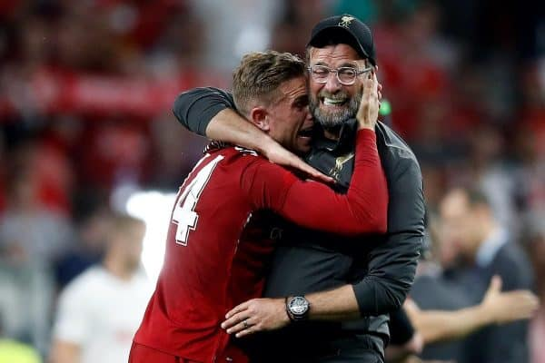 Liverpool's Jordan Henderson celebrates victory with manager Jurgen Klopp after winning the UEFA Champions League Final at the Wanda Metropolitano, Madrid.
