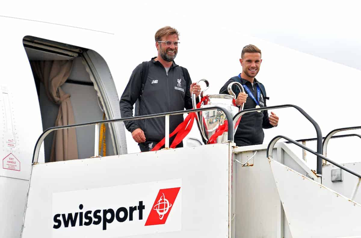 Liverpool manager Jurgen Klopp and Jordan Henderson with the trophy as they arrive back to John Lennon Airport, Liverpool. (PA Images)