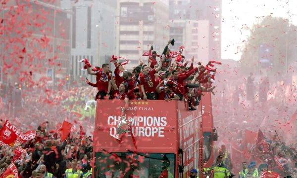 Liverpool players and staff on the bus during the Champions League Winners Parade in Liverpool. (PA Image)