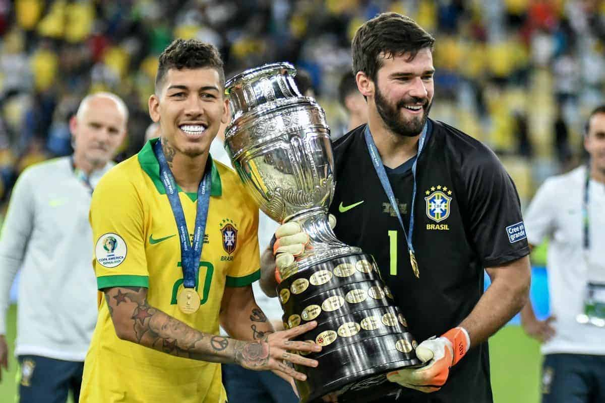 "RIO DE JANEIRO, RJ - 07.07.2019: BRAZIL VS. PERU - Firmino and Alisson celebrate title after the match between Brazil and Peru, valid for the Copa America 2019 final, held this Sunday (07) at the Maracan"" Stadium in Rio de Janeiro, RJ. (Photo by Nayra Halm/Fotoarena/Sipa USA)"