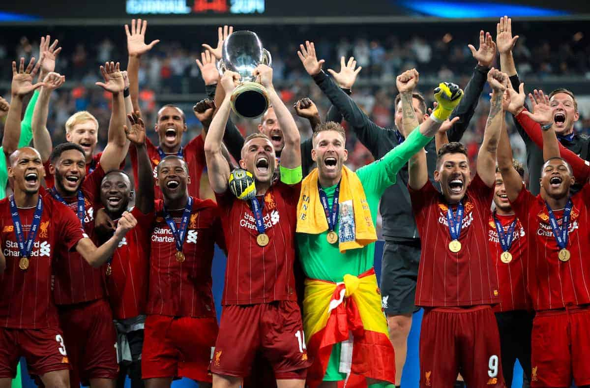 Liverpool's Jordan Henderson lifts the trophy after his side win the UEFA Super Cup Final at Besiktas Park, Istanbul. ( Adam Davy/PA Wire/PA Images)