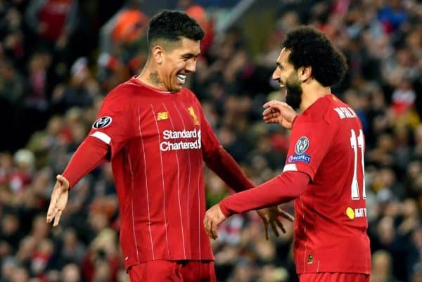 Liverpool's Mohamed Salah celebrates scoring his side's fourth goal of the game with teammate Roberto Firmino