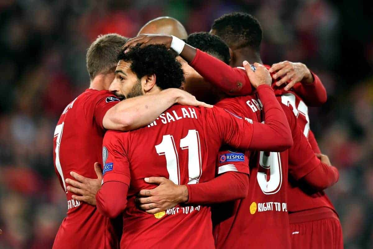 Liverpool's Mohamed Salah celebrates scoring his side's fourth goal of the game with teammates
