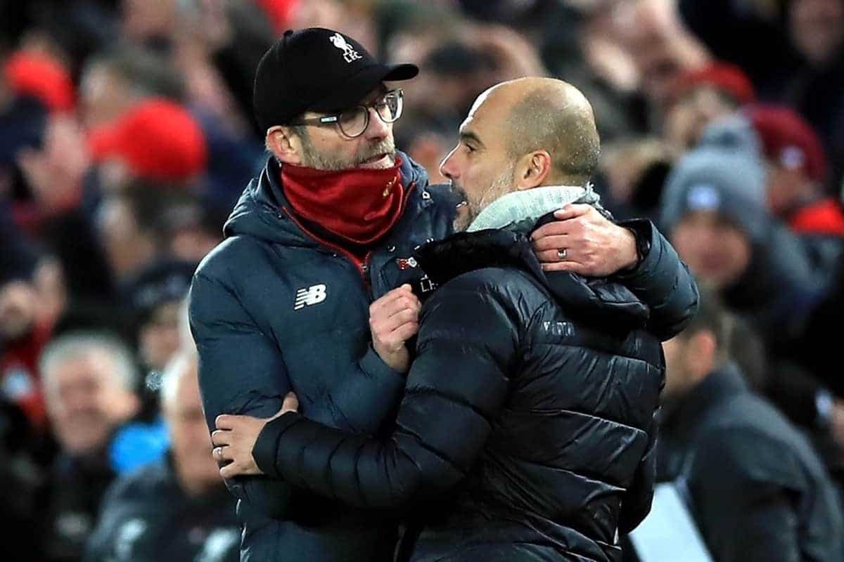 Liverpool manager Jurgen Klopp (left) and Manchester City manager Pep Guardiola hug after the final whistle during the Premier League match at Anfield, Liverpool.