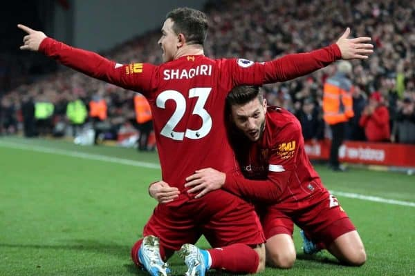 Liverpool's Xherdan Shaqiri (left) celebrates scoring his side's second goal of the game with team-mate Adam Lallana during the Premier League match at Anfield, Liverpool.