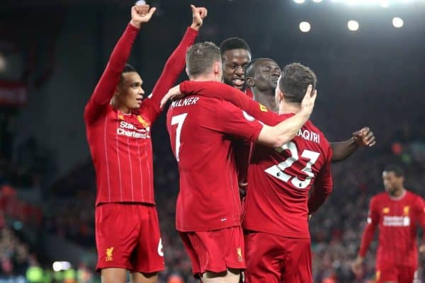 Liverpool's Xherdan Shaqiri (right) celebrates scoring his side's second goal of the game with team-mates during the Premier League match at Anfield, Liverpool.