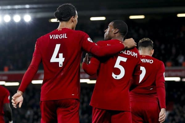 Georginio Wijnaldum (r) of Liverpool celebrates with Virgil Van Dijk after scoring his teams fifth goal of the game during the Premier League match at Anfield, Liverpool. Picture date: 4th December 2019. Picture credit should read: James Wilson/Sportimage via PA Images