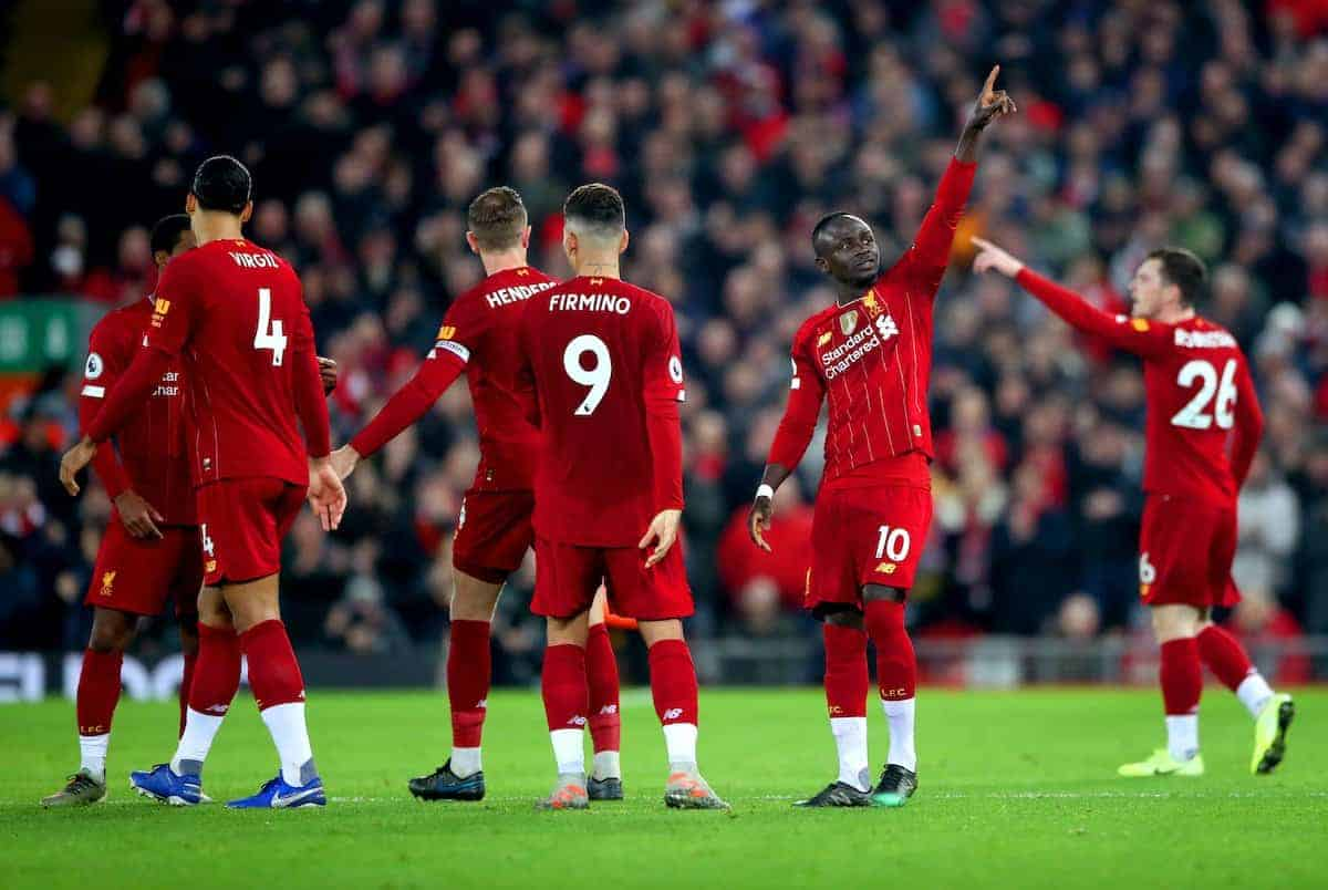Liverpool's Sadio Mane (second right) celebrates scoring his side's first goal of the game with his team mates during the Premier League match at Anfield Stadium, Liverpool.
