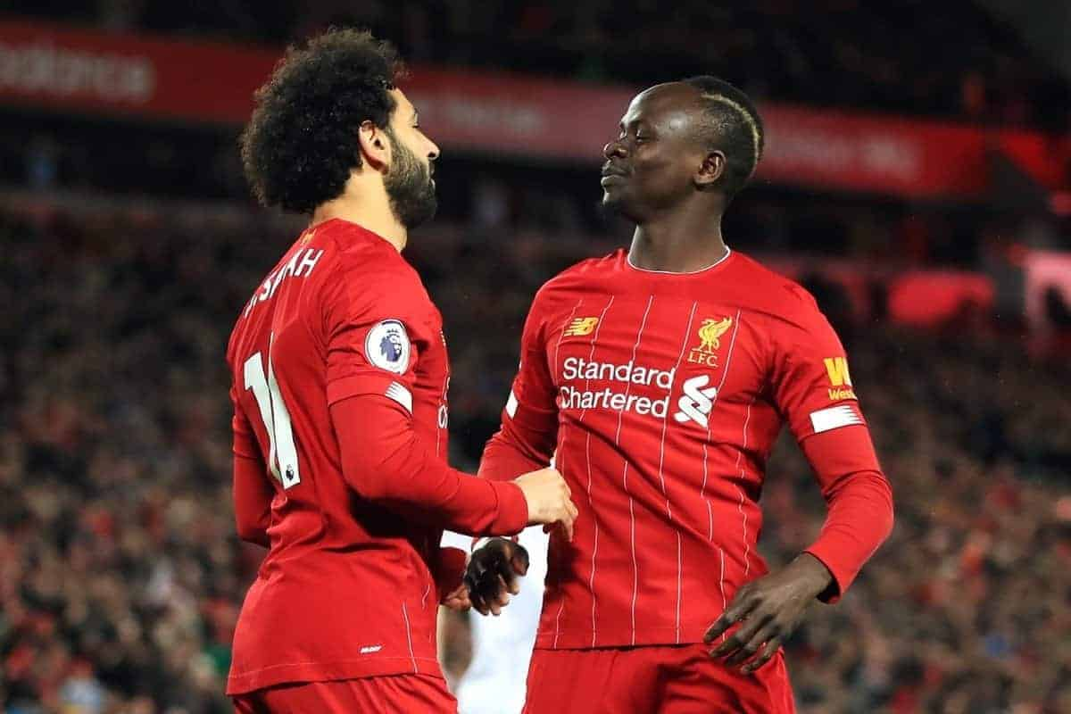 Liverpool's Mohamed Salah (left) celebrates scoring his side's first goal of the game with Sadio Mane during the Premier League match at Anfield, Liverpool.