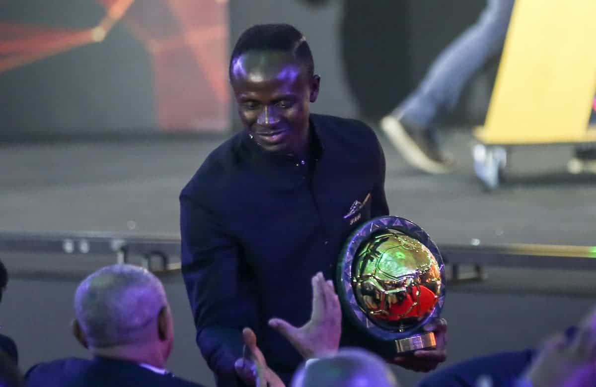 Sadio Mane, winner of the Player of the Year award, shakes hands with CAF†President Ahmad Ahmad during the 2019 CAF Awards ceremony at Albatros Citadel. Photo: Ibrahim Youssef/dpa