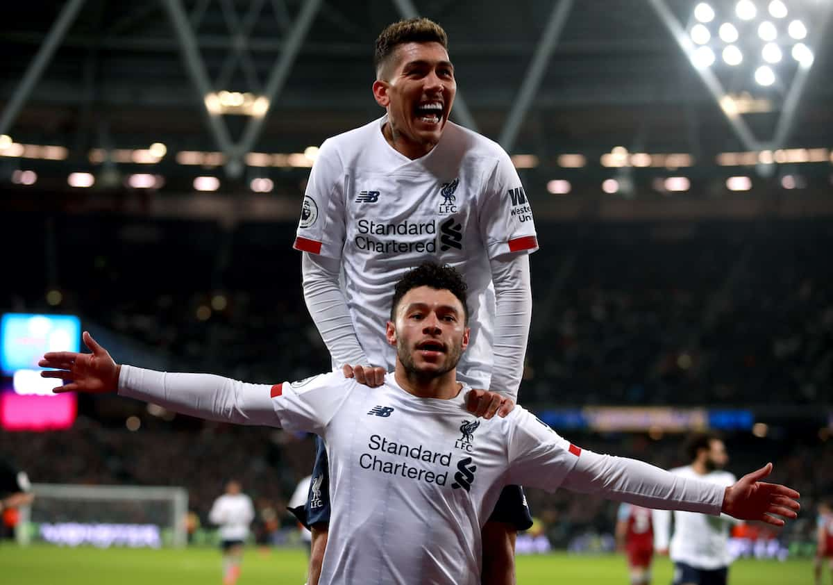 Liverpool's Alex Oxlade-Chamberlain celebrates scoring his side's second goal of the game with team mate Roberto Firmino during the Premier League match at London Stadium. PA Image: Adam Davy/PA Wire.