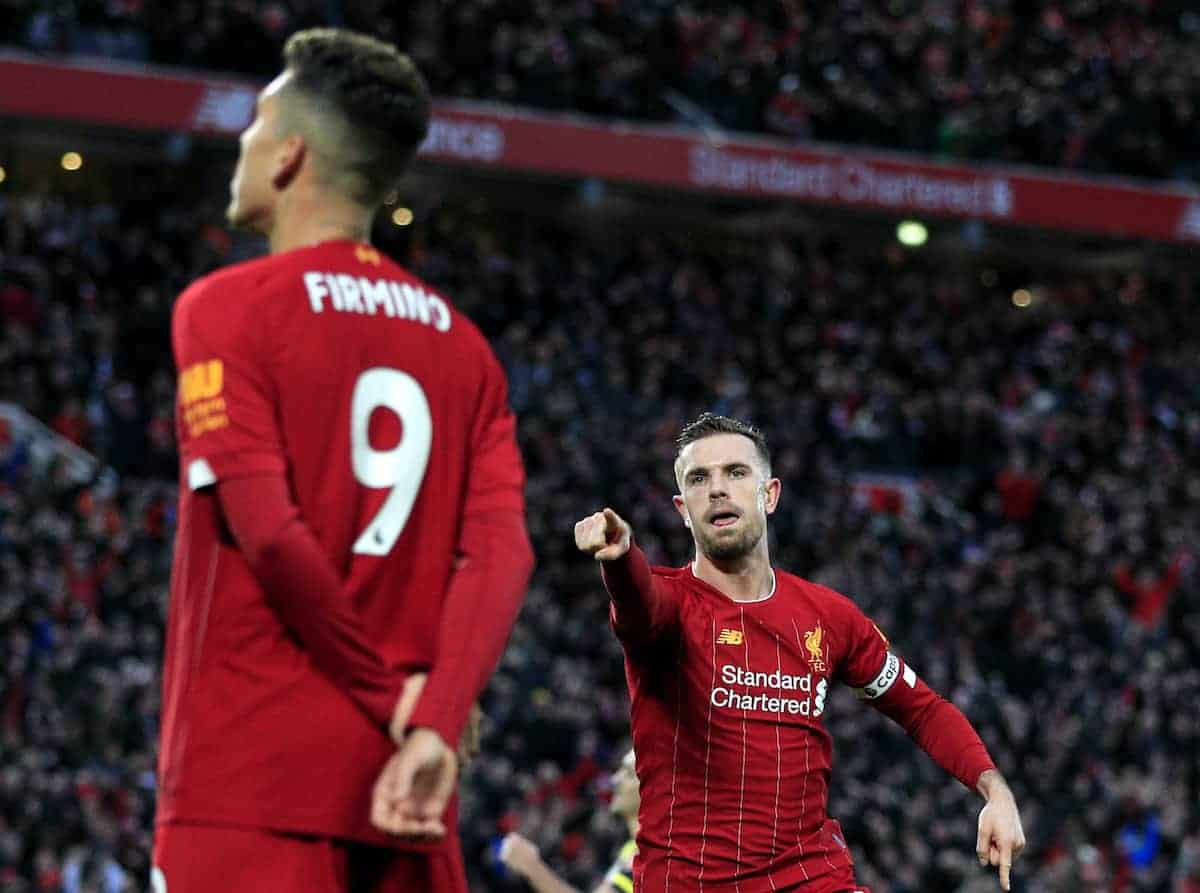 Liverpool's Jordan Henderson (right) celebrates scoring his side's second goal of the game during the Premier League match at Anfield, Liverpool. (Peter Byrne/PA Wire/PA Images)