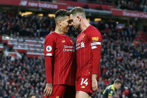 Jordan Henderson (r) of Liverpool celebrates with Roberto Firmino after scoring the second goal of the game during the Premier League match at Anfield, Liverpool. Picture date: 1st February 2020. Picture credit should read: James Wilson/Sportimage via PA Images