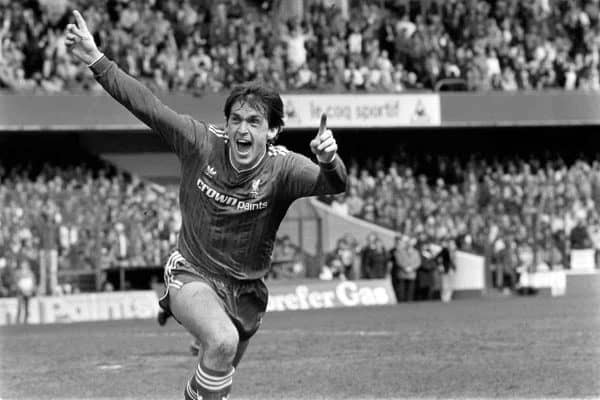 Liverpool's Kenny Dalglish celebrates after scoring the winning goal, which wrapped up the League Championship for his team