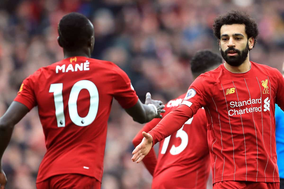 Salah and Mane celebrate. (Mike Egerton/PA Wire/PA Images)