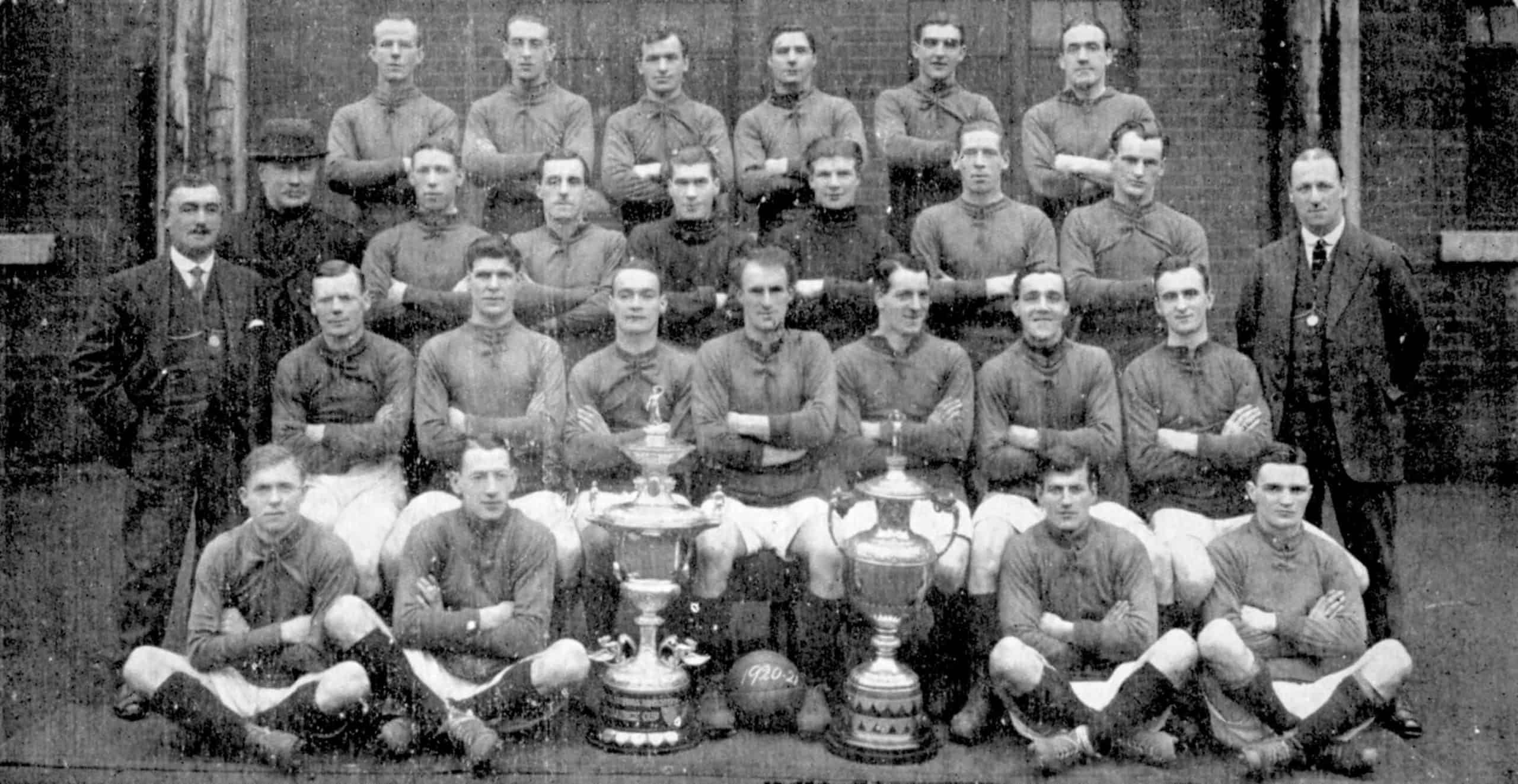 Liverpool team group: (back row, l-r) Dick Johnson, Tom Miller, Willie Cunningham, Jim Penman, Peter McKinney, Billy Lacey (third row, l-r) Trainer W Connell, Dick Forshaw, Harry Chambers, Elisha Scott, Harold McNaughton, Jock McNab, Billy Matthews, George Patterson (second row, l-r) Manager David Ashworth, Jackie Sheldon, Jack Bamber, Tommy Lucas, Ephraim Longworth, Donald McKinlay, Tom Bromilow, Bert Pearson, Secretary (front row, l-r) Jones, Bill Jenkinson, Lancashire Cup, Liverpool Cup, Harry Lewis, Walter Wadsworth