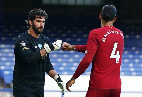 Liverpool goalkeeper Alisson fist bumps Virgil van Dijk during the Premier League match at Goodison Park, Liverpool. (Jon Super/NMC Pool/PA Wire/PA Images)