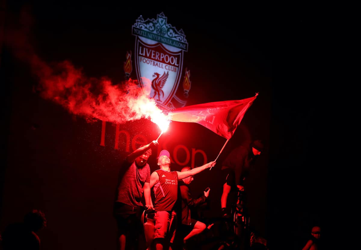 Liverpool fans let off flares outside Anfield, Liverpool. (Martin Rickett/PA Wire/PA Images)