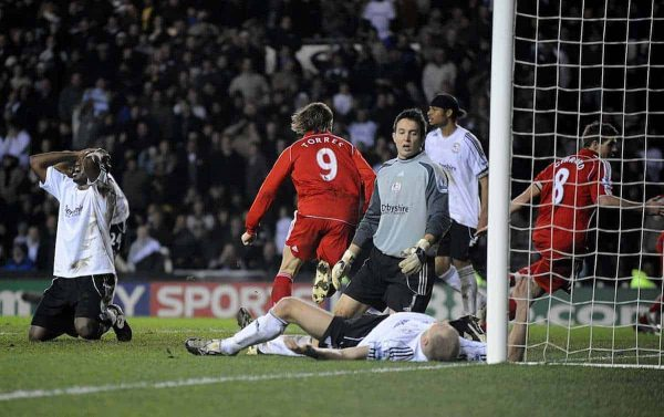 Liverpool's Steven Gerrard scores the winning goal of the game as Derby County players sit dejected