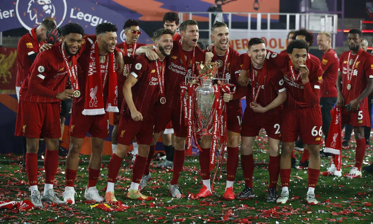 Liverpool celebrate with the Premier League trophy after the Premier League match at Anfield, ( Phil Noble/PA Wire/PA Images)