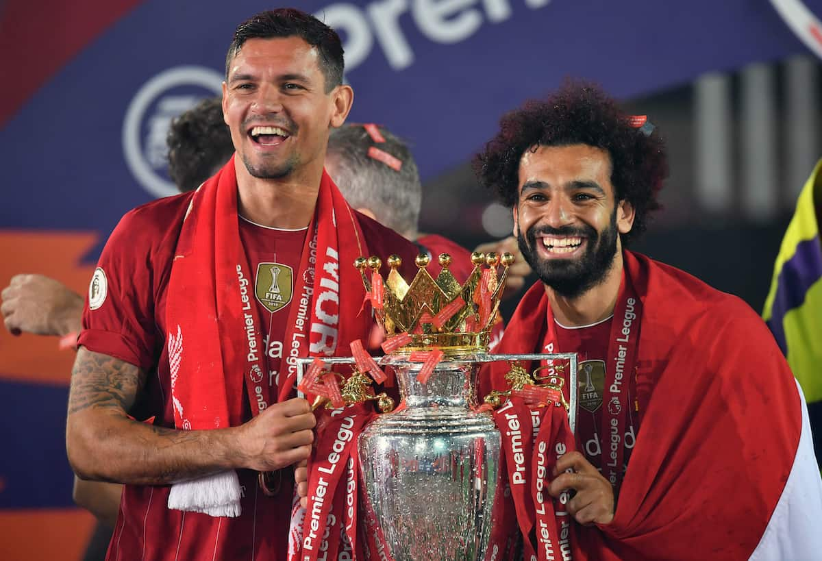 Liverpool's Dejan Lovren and Mohamed Salah lift the Premier League Trophy at Anfield. PA Photo. ( Paul Ellis/PA Wire/PA Images)