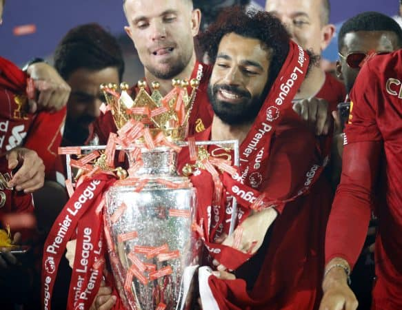 Liverpool's Mohamed Salah celebrates with the Premier League trophy after the Premier League match at Anfield, Liverpool. PA Photo. ( Phil Noble/PA Wire/PA Images)