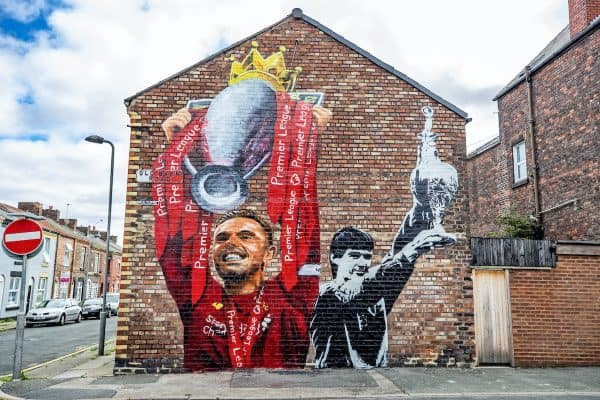 A new mural of Liverpool captain Jordan Henderson lifting the Premier League trophy and former captain Alan Hansen lifting the league trophy by artist Paul Curtis on the gable end of a house on Old Barn Road in Anfield, Liverpool. (Peter Byrne/PA Wire/PA Images)