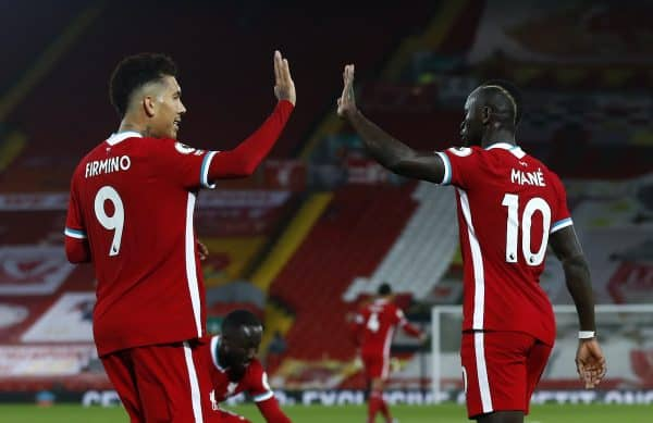 Liverpool's Sadio Mane celebrates scoring his side's first goal of the game with Roberto Firmino (left) during the Premier League match at Anfield, Liverpool. (Jason Cairnduff/PA Wire/PA Images)